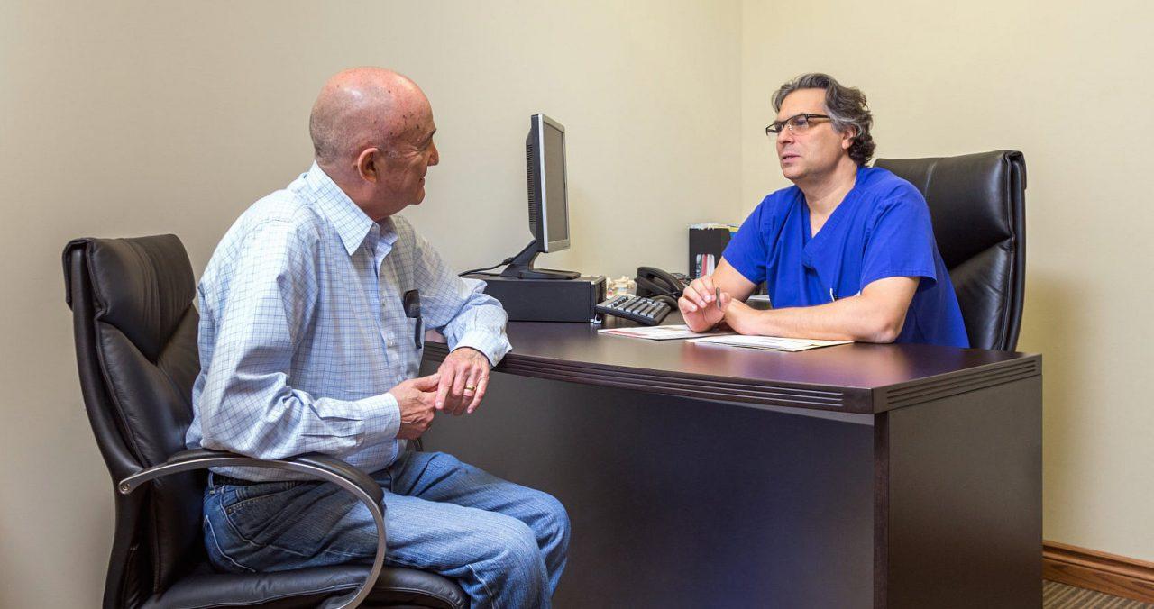 Dr. Fleshner with a patient